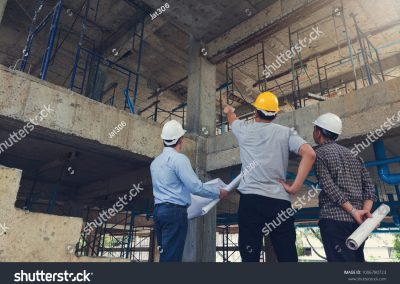 stock-photo-construction-concept-of-engineer-and-architect-working-at-construction-site-with-blue-print-1006780723